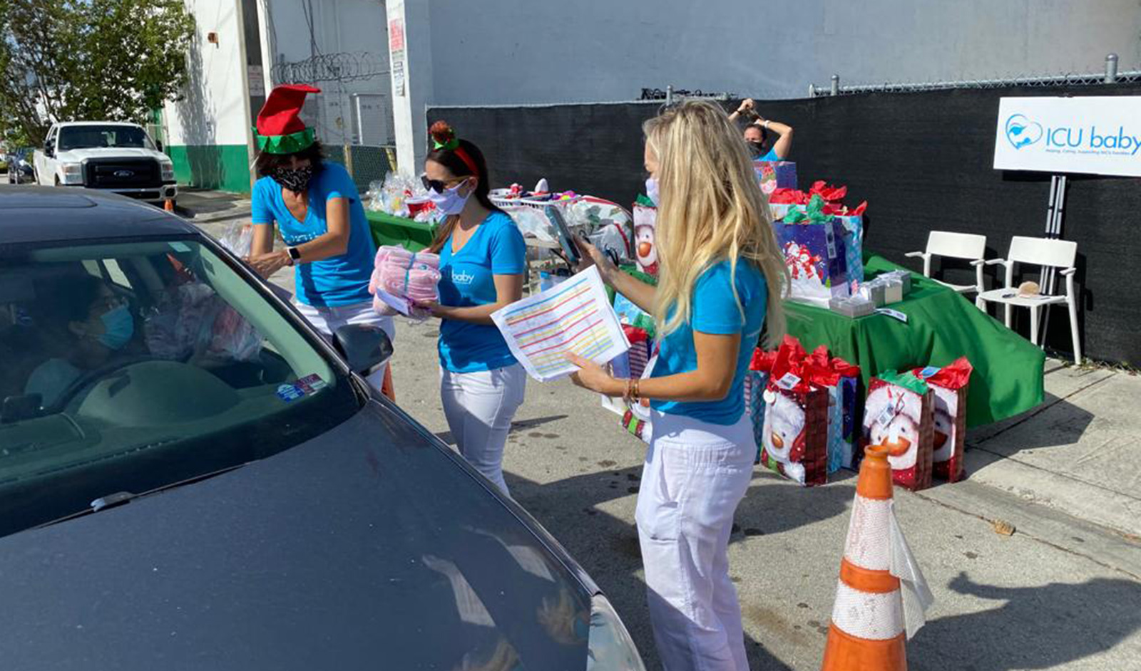 """Giving out gifts at A """"Drive-Thru"""" Christmas Celebration"""